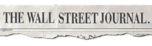 The Wall Street Journal printed in capitol letters on a newspaper